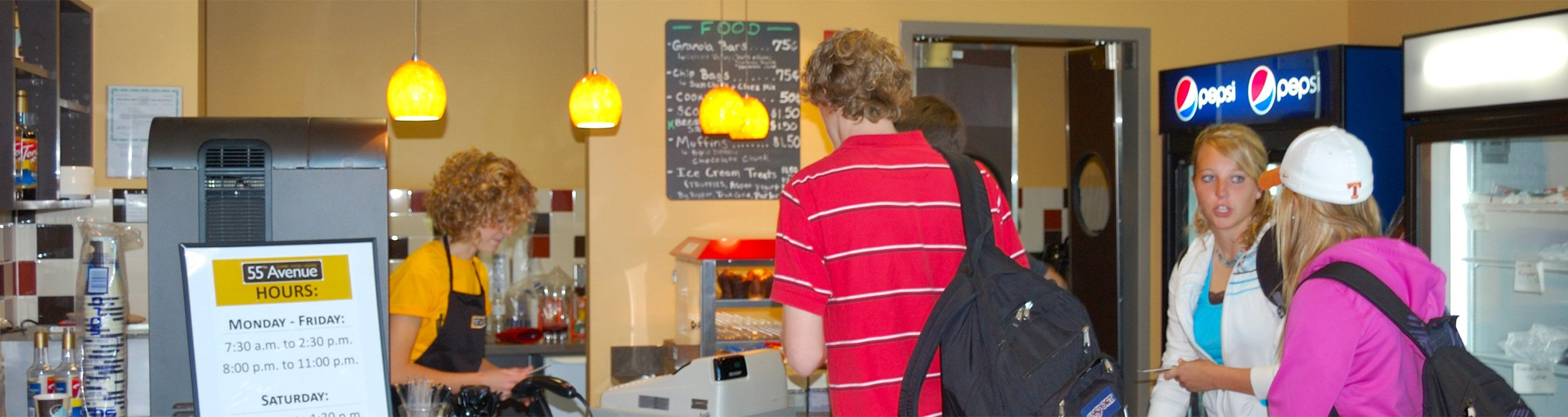 Students stand in line at a cafe.