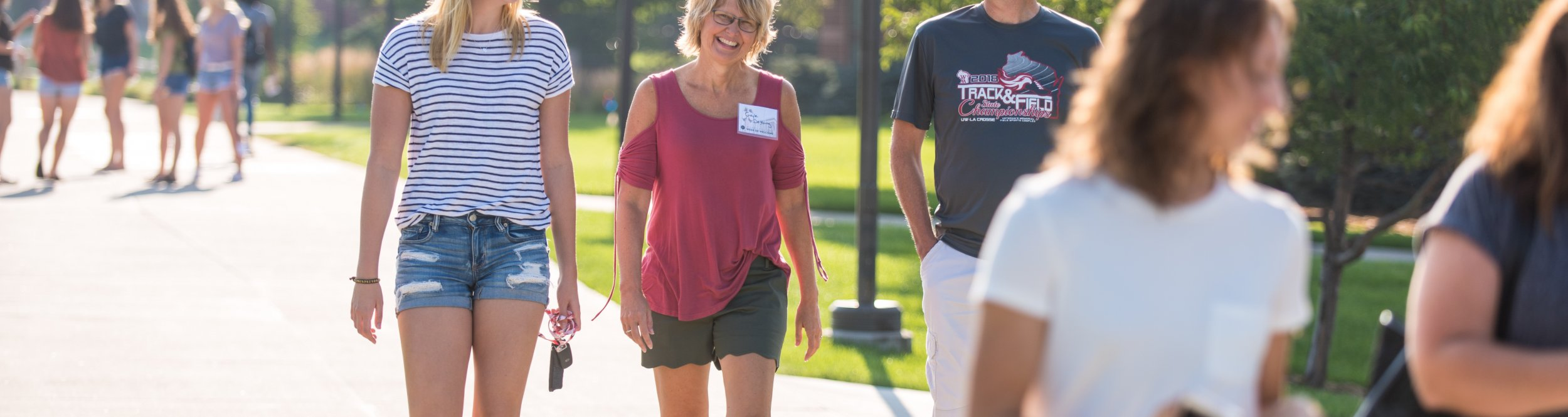 Dordt parents walk with a student.