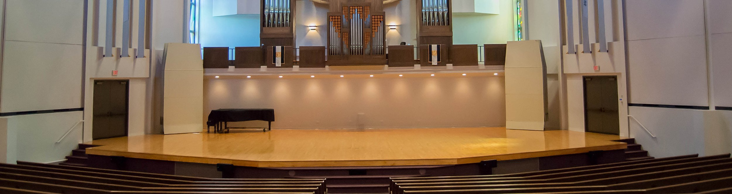 An empty stage in the B.J. Haan Auditorium.
