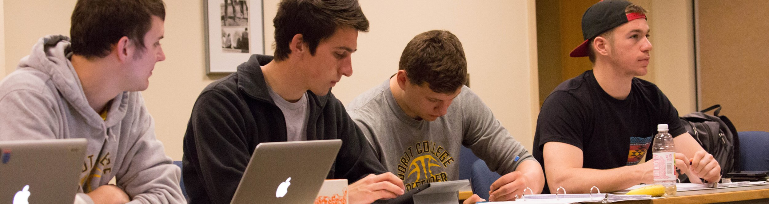 Students work on their laptops.