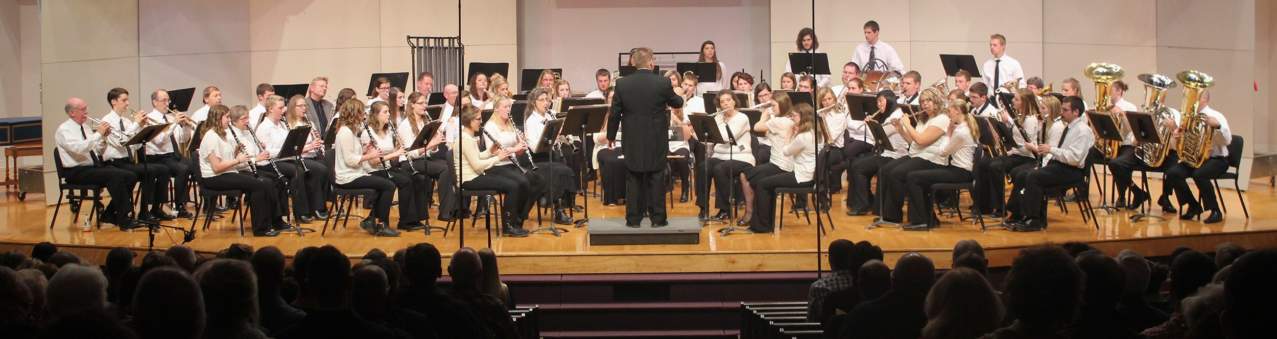 The Dordt campus-community band giving a performance on stage.
