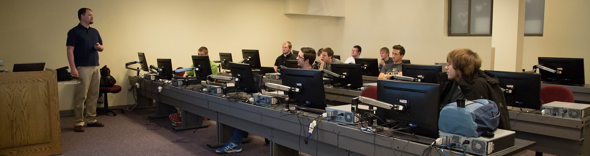 Students working in a computer science classroom.