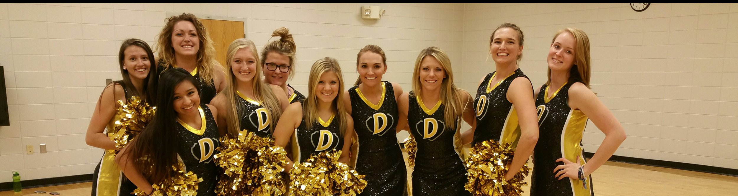 The Dordt dance team poses and smiles.
