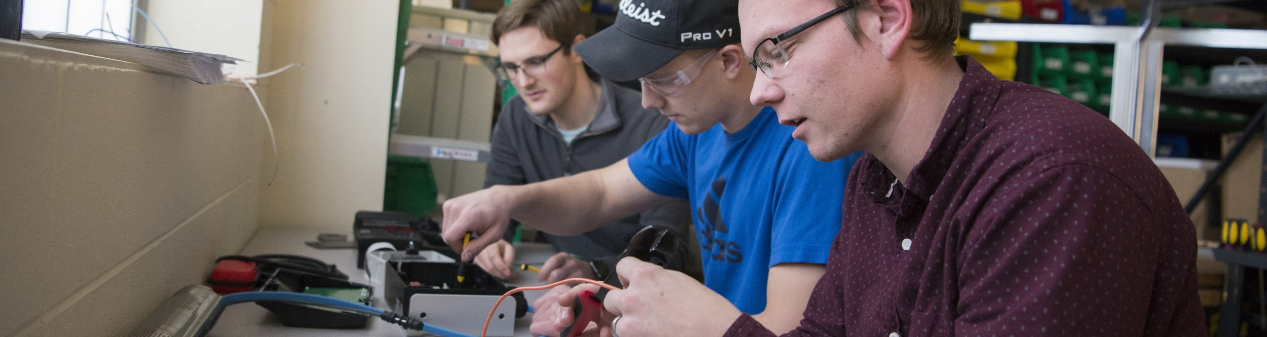 Engineering students work on wires.