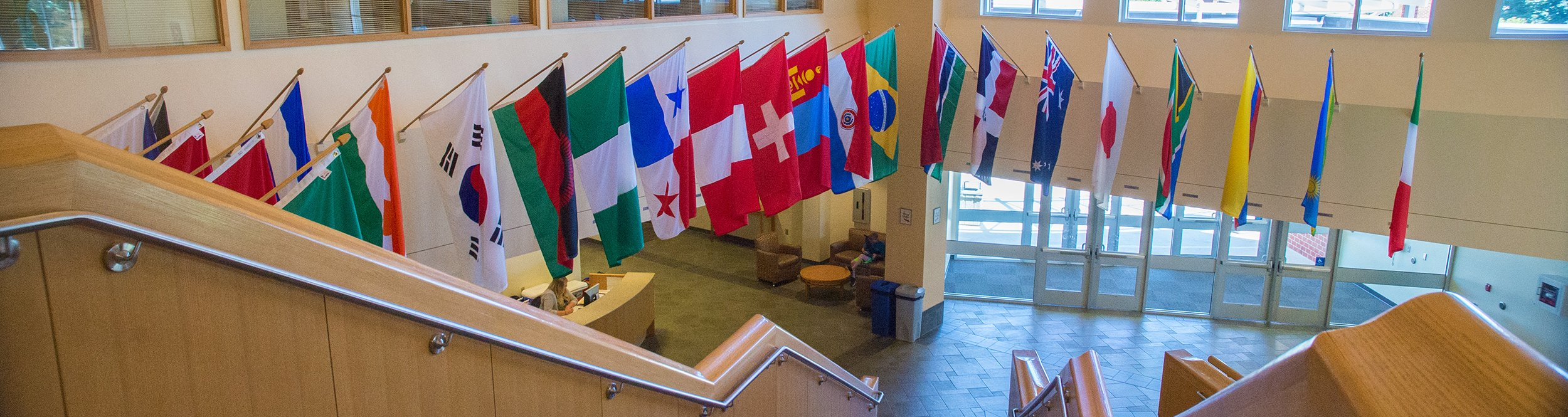 Flags of different countries hanging on the walls.
