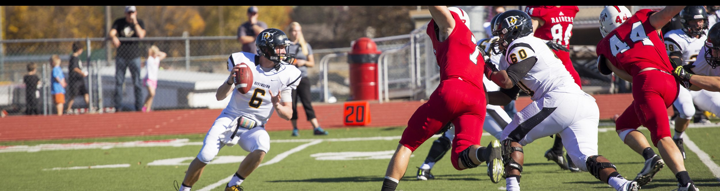 A Dordt football player prepares to throw the ball.