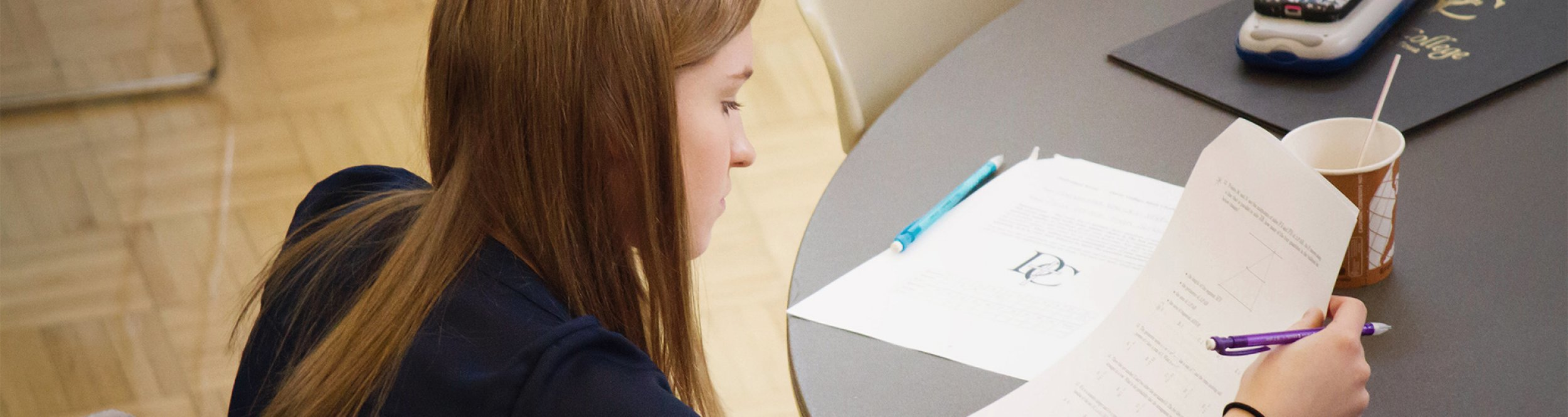 A student looks at her paper.