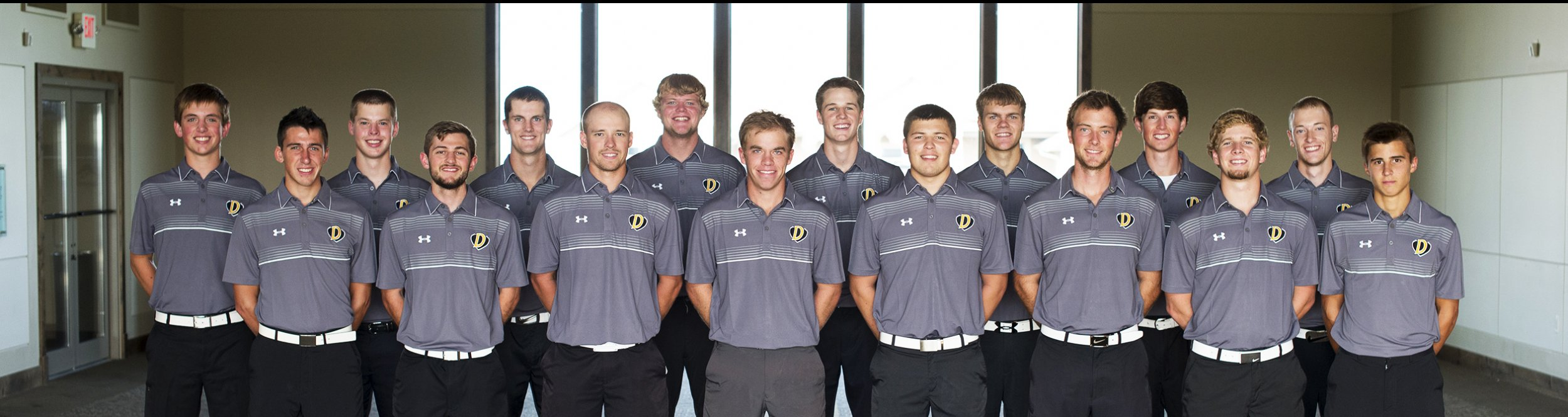 The men's golf team poses for a team photograph.