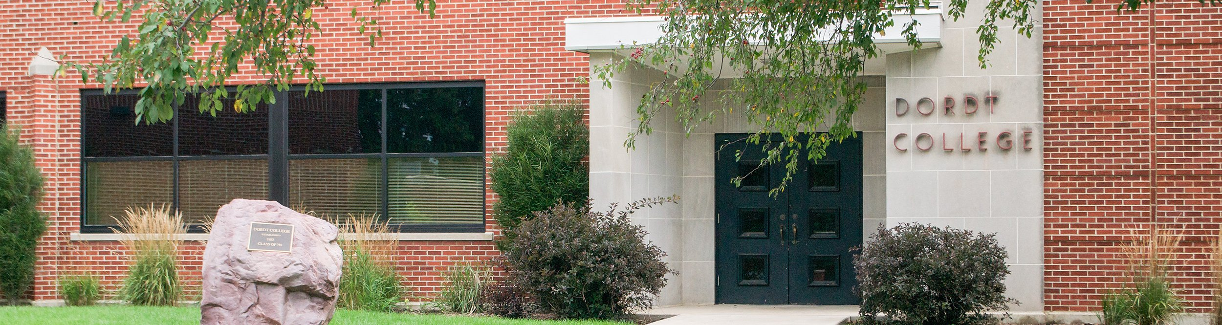 The original entrance to Dordt's campus, a concrete doorway.