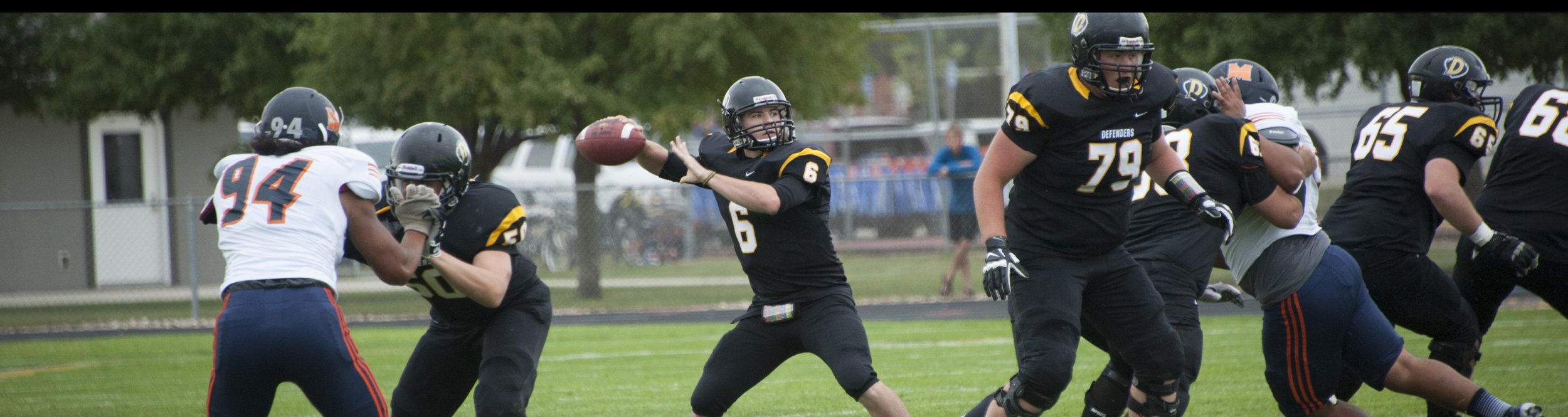 A Dordt football player gets ready to throw the ball.