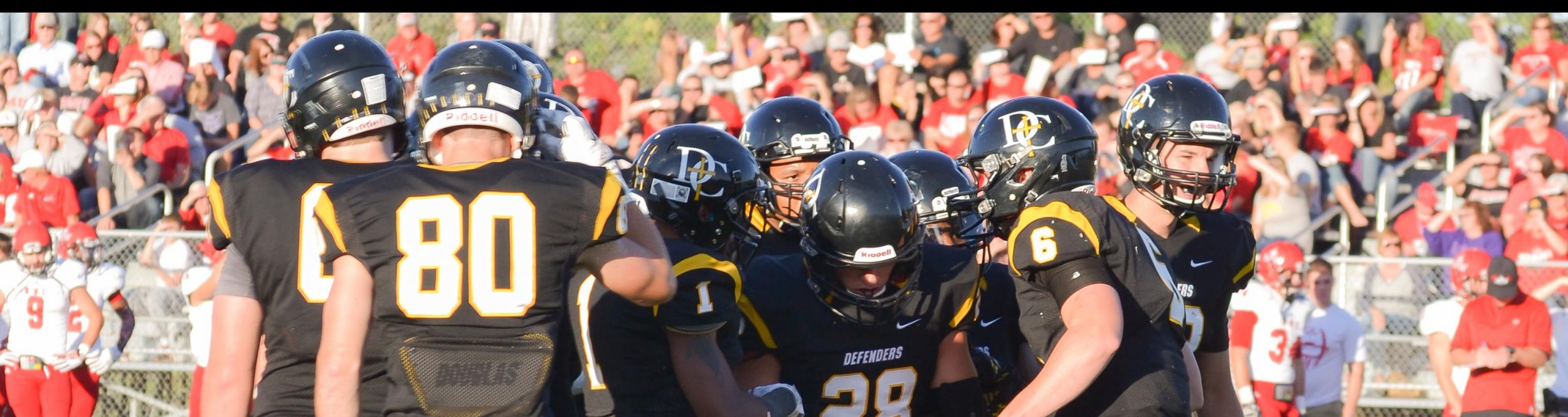 Dordt football players help one of their teammates.