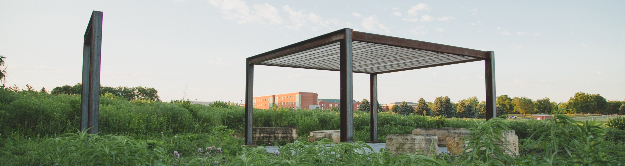A prairie with metal structures in it.