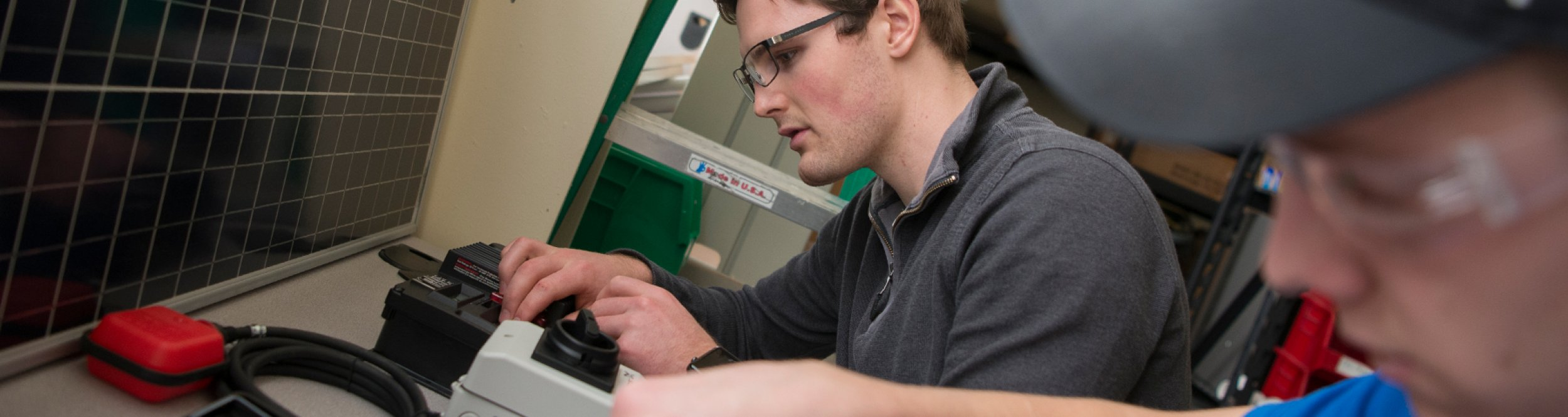 A student looks at a machine.
