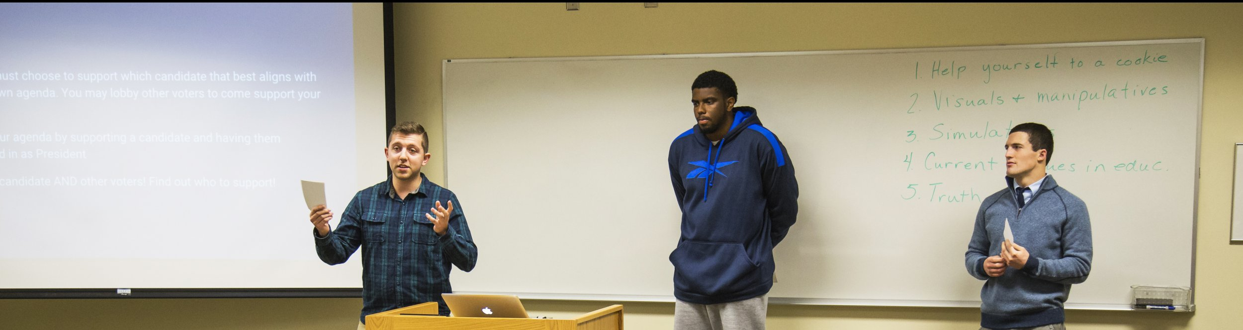 Dordt students give a presentation to their classmates.
