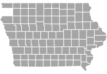 A grey map of Iowa and its counties.